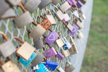 Love Locks Focusing On A Purple Lock With White Heart