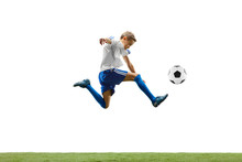 Young Boy With Soccer Ball Run...