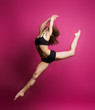 canvas print picture - sporty girl in a jump on a pink background