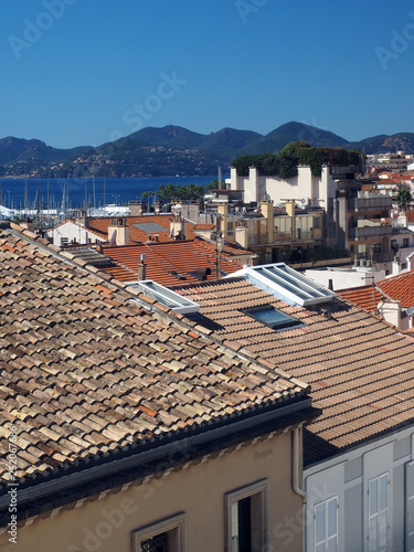 Fotografie, Obraz  Mediterranean style shingle tiles are seen on rooftops  Cannes, France, Europe