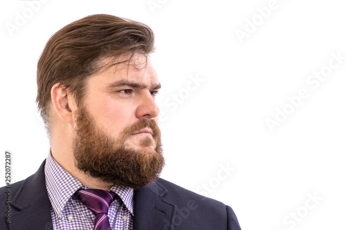 Obraz na plátně  face profile portrait of a big handsome serious bearded business man in a dark s