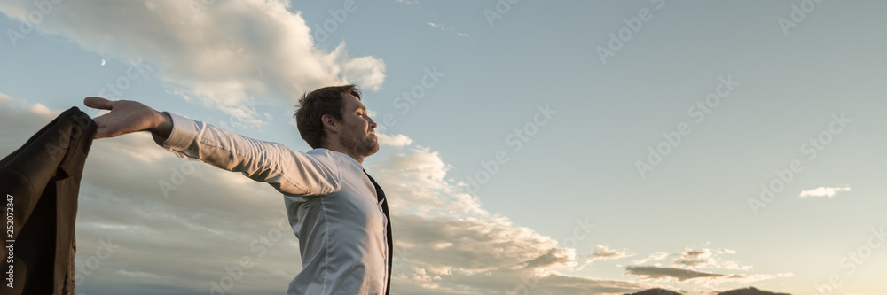 Fototapety, obrazy: Businessman embracing life standing under cloudy sky