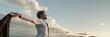 Leinwanddruck Bild - Businessman embracing life standing under cloudy sky
