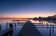 Tranquil dawn at a jetty at the Leekstermeer, in Holland.