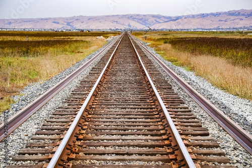 Fotografie, Obraz  Railroad tracks across marshland, Alviso, San Jose, south San Francisco bay area