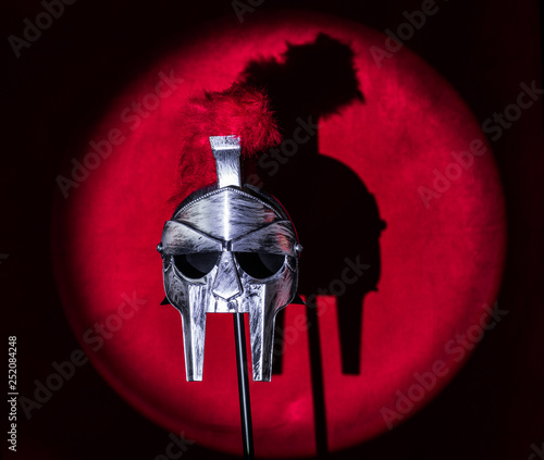 Photo  spartan helmet on a red background