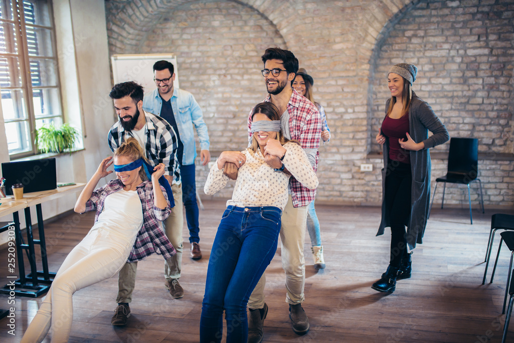 Fototapeta Business people making team training exercise during team building seminar, play a game of trust