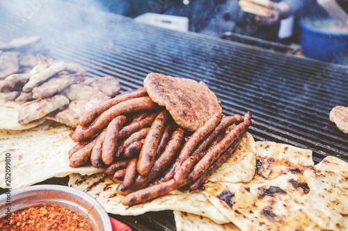 Fototapeta freshly grilled sausages at street food markets obraz