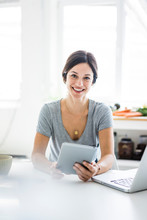 Happy Woman Sitting At Desk, Working From Home, Using Laptop