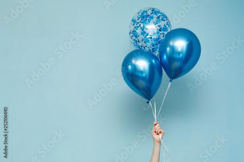 bright matte balloons on a blue background Fototapeta