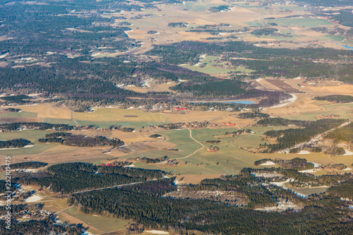 Staande foto Rotterdam Sweden landscape with forest, field and small settlements north of Stockholm during winter - aerial view
