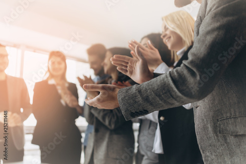 Fotografía  Multiracial group of business people clapping hands to congratulate their boss -