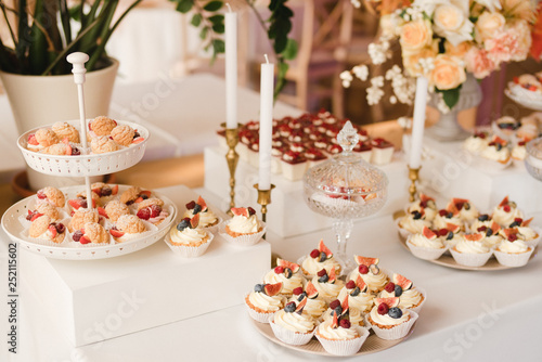 Candy Bar With Tasty Desserts And Appetizers At Wedding Reception