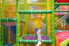 Happy Little Boy Having Fun In Amusement In Play Center. Child Playing On Indoor Playground.