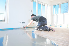 Plasterer During Floor Coverin...