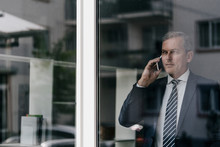 Mature Businessman On Cell Phone