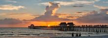 USA, Florida, Naples, Panoramic View Of Naples Pier With Crowd Enjoying Sunset