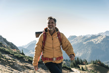 Austria, Tyrol, Happy Man Hiking In The Mountains