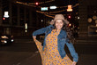 Happy young woman on the street at night