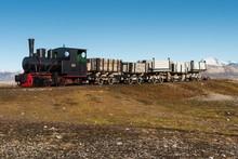 Historic Mine Train In Front Of The Kongsfjorden, Ny-Alesund, Spitsbergen, Svalbard Islands, Svalbard And Jan Mayen, Norway, Europe