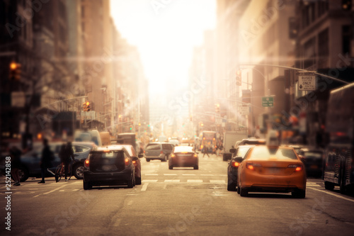 Spoed Foto op Canvas New York Defocused blur along busy New York City street in midtown Manhattan with cars and anonymous people with sunlight