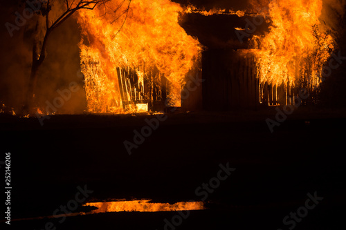 Wooden Shed Caught on Fire at Night Time