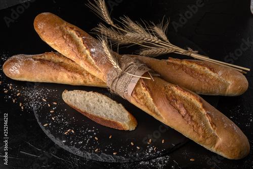 Fototapeta Freshly baked delicious baguette bread Homebaked. Useful, tasty, nutritious. obraz