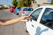 woman getting her key in the car. Concept of rent car or buying car.Travel vacation with rental car.travel with pleasure. learning to drive a car.Car key in hand.remote control car alarm systems.