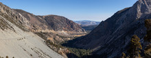 Panoramic View Of A Scenic Road, Tioga Pass, In The Valley Surrounded By Mountains. Taken Near Lee Vining, California, United States.