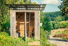 Wooden Shed Ecological Composting Toilet On Countryside Eco Farm - Concept Image