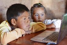 Serious Native American Kids Using Laptop.