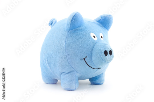 Fototapeta Stuffed blue piggy doll isolated on white background.
