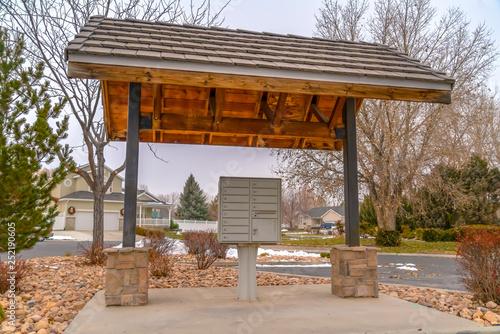 Fotografie, Obraz  Outdoor cluster mailbox under a sidewalk shed