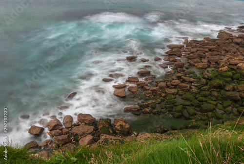 Fotografering  View of rocky coast in long exposure. In Cantabria. Spain