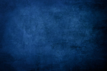 Dark blue grungy distressed canvas bacground
