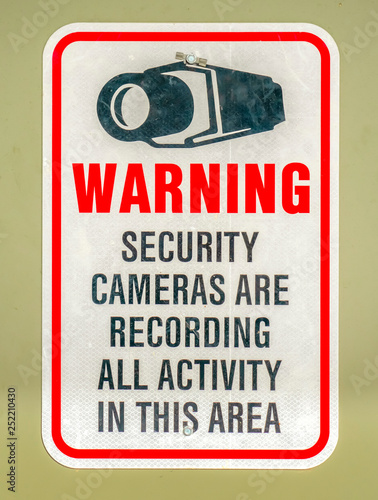 Fotografie, Obraz  Warning sign on an area with security cameras
