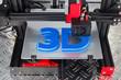 canvas print picture - Red black 3D printer printing blue logo symbol on metal diamond plate future technology modern concept