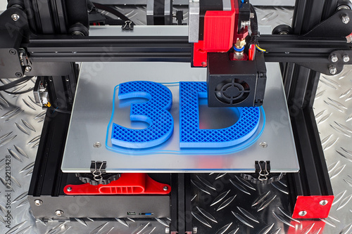 Obraz na plátně Red black 3D printer printing blue logo symbol on metal diamond plate future tec