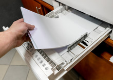 Paper In Printer. Sets The Paper Stack In The Laser Printer.