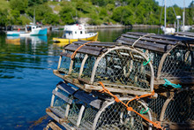 Stacks Of Traditional Wooden Lobster Traps On The Wharf In A Nova Scotia Fishing Village.