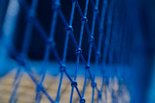 Knotted Rope Mesh Blue Netting Fencing Protection For Safety On Playgrounds, Amusement Rides. Selective Focus
