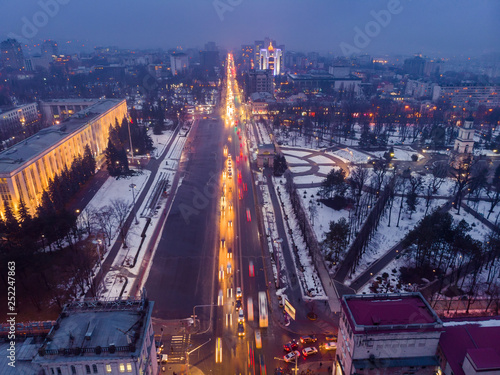 Keuken foto achterwand Canada City center Chisinau at night with light and blue sky, government building and arch, Moldova. Aerial drone view