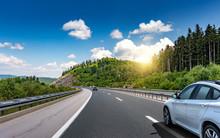 Car Driving On Highway Surroun...