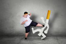 Asian Obese Man Kicking A Ciga...