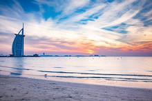 DUBAI, UAE - FEBRUARY 2018 :The World's First Seven Stars Luxury Hotel Burj Al Arab At Night Seen From Jumeirah Public Beach In Dubai, United Arab Emirates