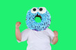 Leinwandbild Motiv Happy obese man with donut head in the studio