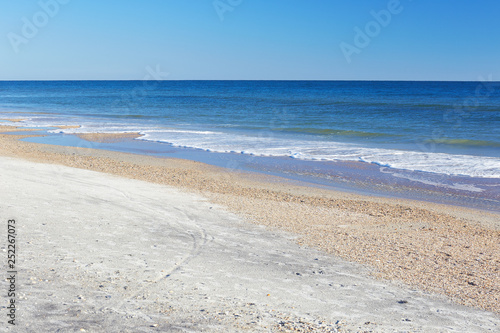 Ocean waves and sand along the beach at Little Talbot Island State Park near Jacksonville, Florida