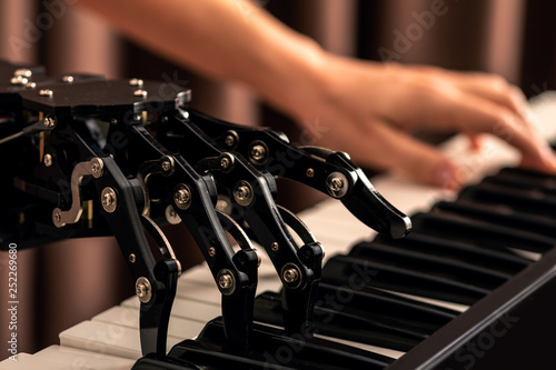 Human with neural hand prosthesis playing piano Canvas Print