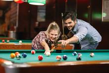 Billiard- Smiling Couple Shooting Pool Ball  .