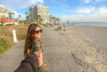 Beautiful Girl Smiling At Coronado Beach, San Diego, California
